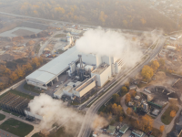 A factory with emissions visible overhead