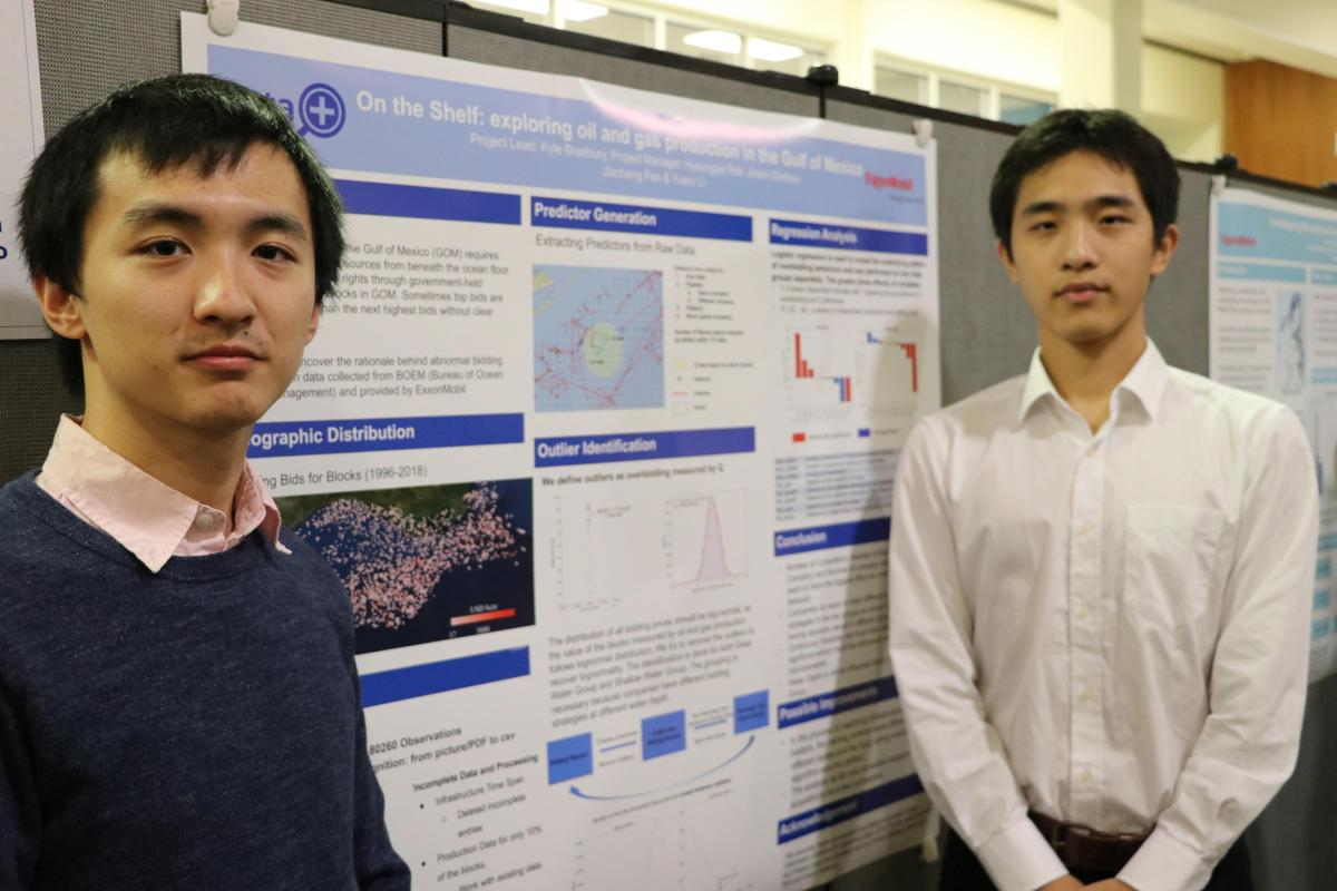 Jason and Josh standing in front of their Data+ poster