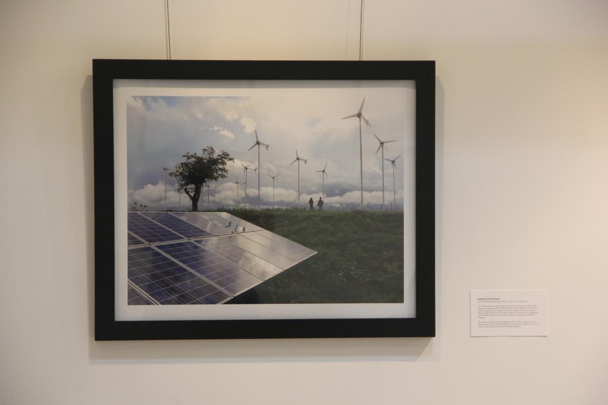 Solar panels and wind turbines in a field