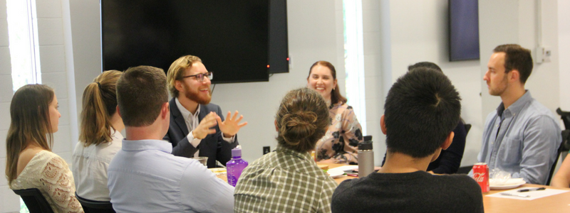 Duke alum Julian Spector,students,energy journalism talks,power lunch